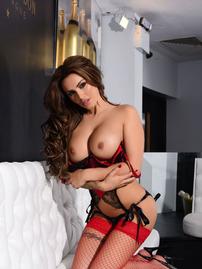Gemma Massey Posing In Red Stockings