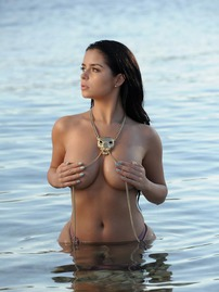Busty Demi Rose Hiding Boobs At The Beach