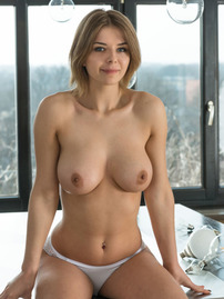 Yelena Strips And Poses Naked On The Dining Table