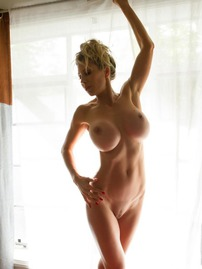 Blonde Beauty Puma Swede Shows Flawless Body