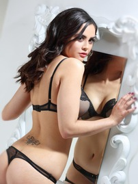 Sexy Brunette Showing Off Her Sexy Stockings