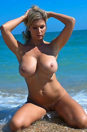 Free Babe Carol Strips On The Beach