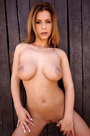 Dora Busty Nude Babe Posing Outdoors