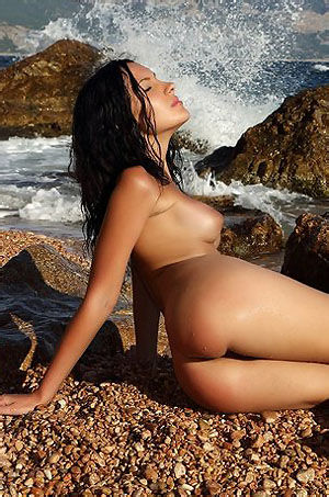 Naked Nadian Posing By The Sea