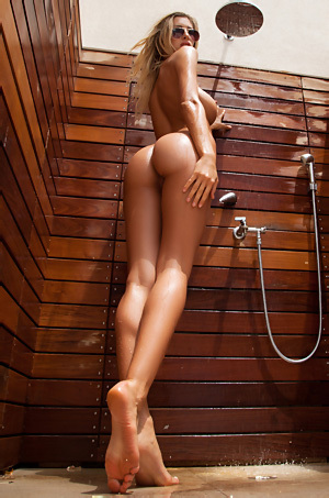 Claudia Takes A Hot Outdoor Shower