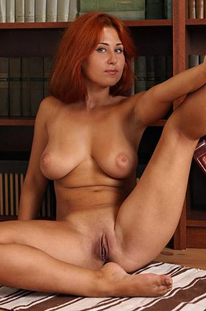 Busty Redhead April
