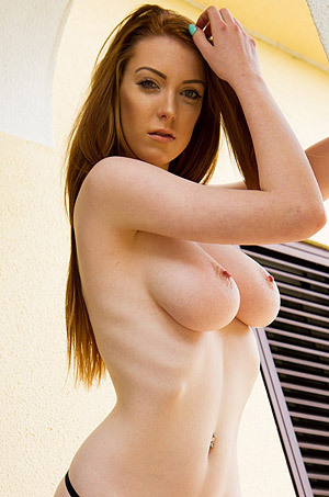 Alice Brooks Reveals Her Breasts