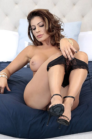 Hot MILF Nikki Capone Stripping In The Bedroom