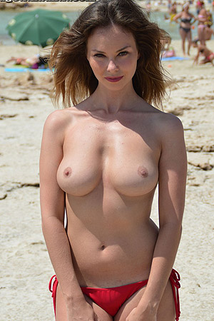 Annie Topless On Beach For Sunbath