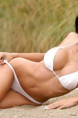 Busty Babe In White Bikini
